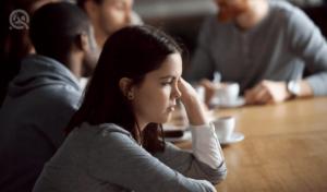 disengaged woman in work meeting